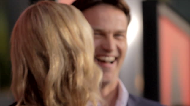 Anna Paquin and Stephen Moyer posing for paparazzi on the red carpet at the Arclight Cinemas Cinerama Dome