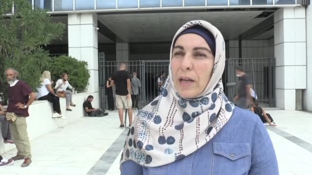 anna stamou from the muslim association of greece says the country's neo-nazi party golden dawn being branded a criminal organisation is a 'great... - grecia stato video stock e b–roll