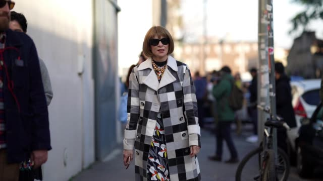 anna wintour wears sunglasses a bejeweled necklace a black and white checkered long trench coat a floral print dress boots outside marni during milan... - boot stock videos & royalty-free footage