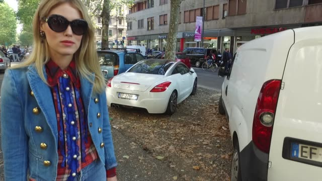 Annabel Rosendahl wearing a Gucci jacket Lewis jeans Coach shirt Céline shoes Louis Vuitton bag and Gucci sunglasses on September 25 2016 in Milan...