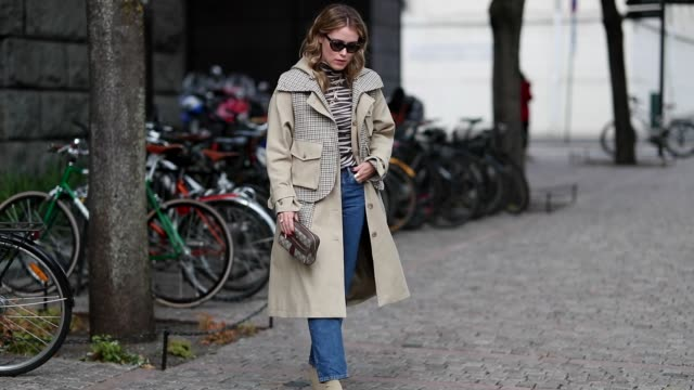 Annabel Rosendahl wearing beige trench coat with checked patterns animal print top denim jeans ankle boots Gucci clutch seen outside Cathrine Hammel...