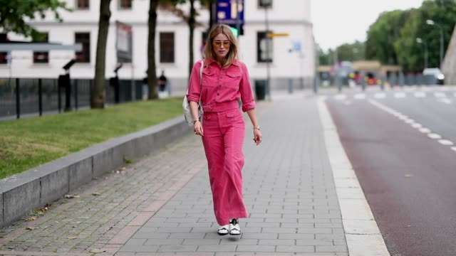 Annabel Rosendahl wearing pink denim jacket and jeans is seen outside the Moire show during Oslo Runway SS19 on August 15 2018 in Oslo Norway