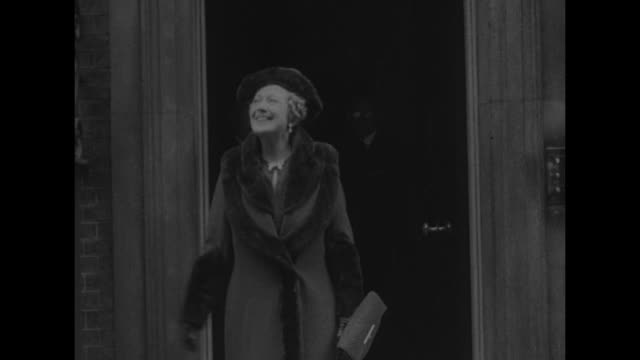 VS Anne Chamberlain wife of British Prime Minister Neville Chamberlain greets and shakes hands with crowd outside 10 Downing Street following the...