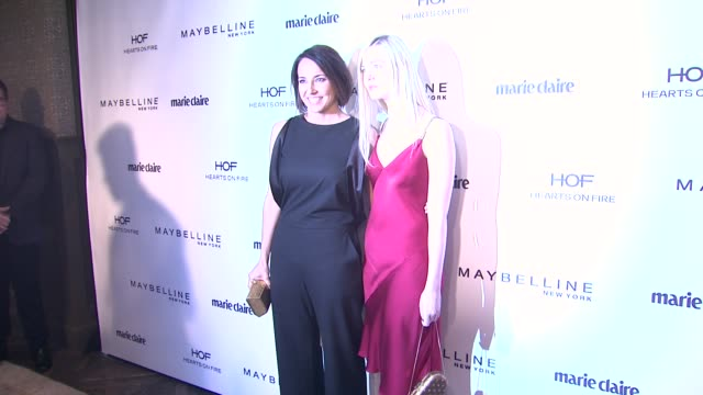 anne fulenwider, elle fanning at marie claire celebrates may cover stars in los angeles, ca 4/8/14 - 赤のドレス点の映像素材/bロール