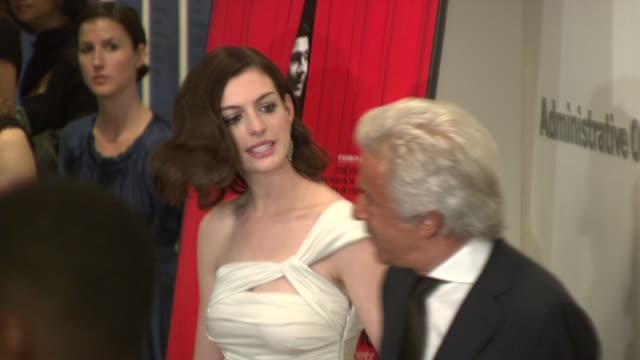 Anne Hathaway and Giancarlo Giammetti at the Valentino The Last Emperor Premiere at New York NY
