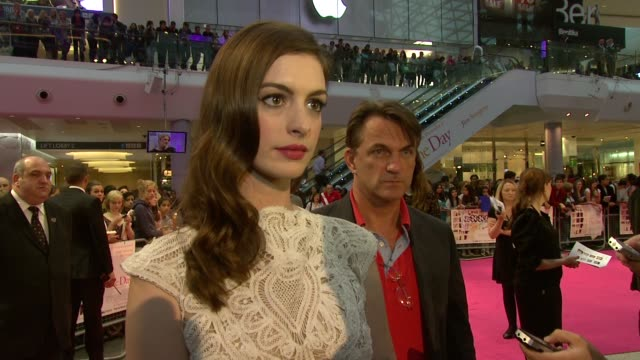 Anne Hathaway on relating to Emma being a late blossomer herself being insecure honour playing Emma at the One Day European Premiere at London England