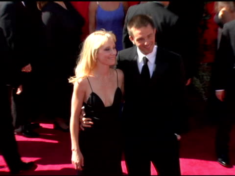 vídeos y material grabado en eventos de stock de anne heche and guest at the 2006 primetime emmy awards arrivals at the shrine auditorium in los angeles, california on september 19, 2004. - premio emmy anual primetime
