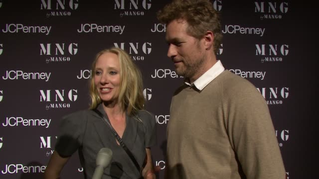Anne Heche and James Tupper talking about her dress from JC Penney and the designs mix design elements at the Launch of MNG by Mango at JCPenney at...