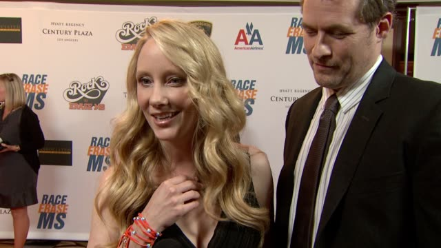 anne heche, james tupper on being a part of the night, her necklace, what she appreciates about the work nancy davis does, what they're most looking... - anne heche stock videos & royalty-free footage