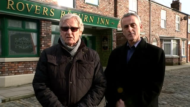 william roache leads tributes england london gir int william roache and kieran roberts live 2way interview from coronation street set in manchester... - ウィリアム・ローチ点の映像素材/bロール