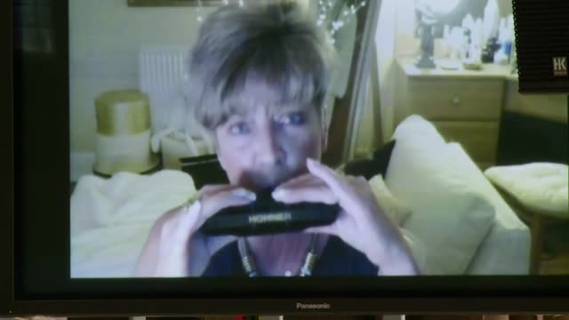 Anne Kirkbride memorial service in Manchester cutaways More of service / Kirkbride on monitor playing the harmonica SOT / Kirkbride brother gives...