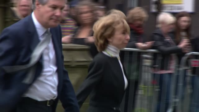 anne kirkbride memorial service in manchester england manchester manchester cathedral ext helen worth arriving at cathedral michael le vell greeting... - マイケル レ ベル点の映像素材/bロール