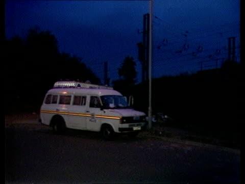 minimal entry ENGLANDHerts area where body found police vans Photofit murderer Forensic work