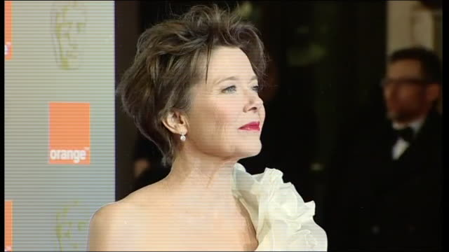 annette bening poses for press on the red carpet at the british academy film awards 2011 - annette bening stock videos & royalty-free footage