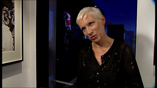 Annie Lennox holds exhibition at Victoria and Albert Museum ENGLAND London INT 'The House of Annie Lennox' headline at exhibition of her costumes...