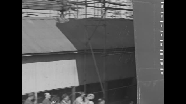 annie reid knox, widow of deceased navy secretary frank knox, hits champagne bottle against the bow of the navy destroyer uss frank knox as it... - widow stock videos & royalty-free footage