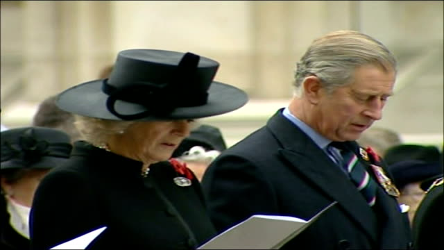 eve of remembrance day events westminster prince charles prince of wales and camilla duchess of cornwall singing hymn at service with war widows at... - 寡婦点の映像素材/bロール