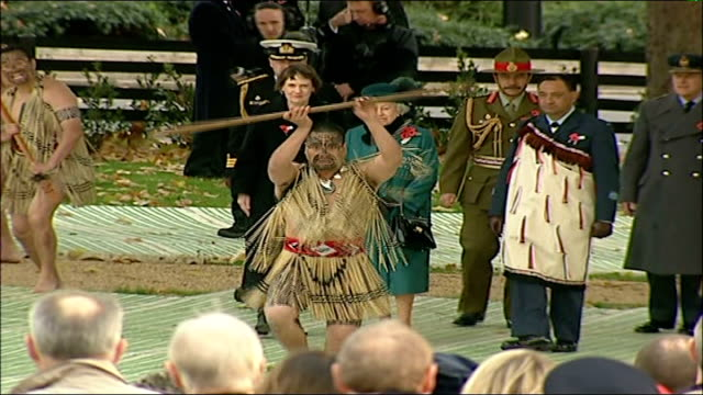 remembrance day ceremonies hyde park queen elizabeth ii and new zealand prime minister helen clark watching maori dancers at ceremony to dedicate war... - 2006 stock videos & royalty-free footage