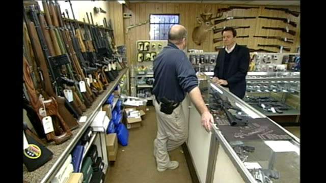 anniversary of columbine high school shooting on 20 april 1999; int reporter to camera colorado: various of woman shooting at target at rifle range... - gedenkveranstaltung stock-videos und b-roll-filmmaterial