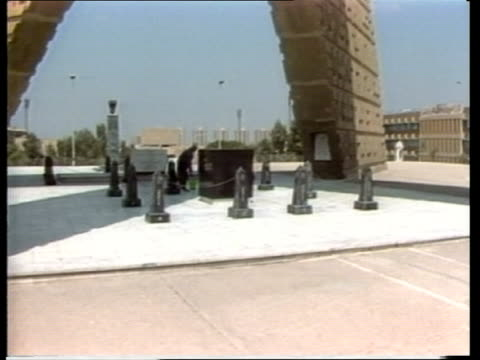 Anniversary of Sadat assassination EGYPT Cairo MS Tomb of the Unknown soldier TILT DOWN 2 soldiers past memorial MS Memorial stone to Anwar Sadat...