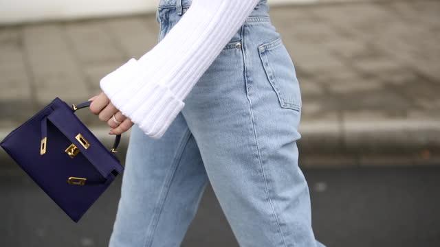 ann-kathrin götze is seen wearing copped white jumper zara, denim jeans saint laurent, white shoes prada, purple bag hermes on march 17, 2021 in... - jeans stock videos & royalty-free footage