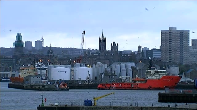 bp announce cut in 300 north sea oil jobs scotland aberdeen ext long shot of aberdeen skyline with harbour and oil storage tanks in foreground ship... - aberdeen scotland stock videos & royalty-free footage
