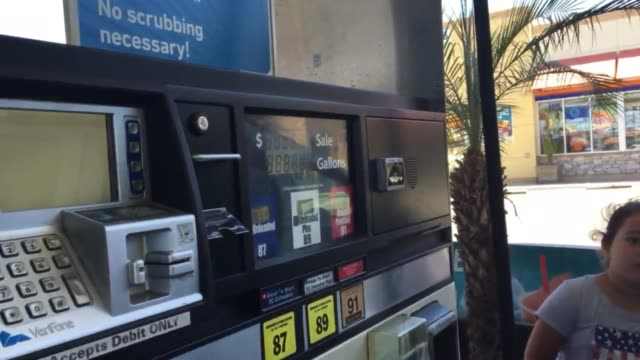 aaa announced the us is seeing the lowest national average of gas prices since 2004 wide medium and closeup shots of arco gas station on the corner... - santa monica blvd stock videos & royalty-free footage