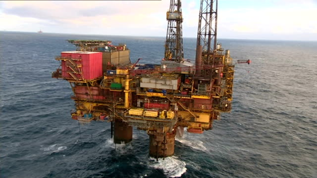 announces fall in profits due to falling oil prices; north sea: brent oil field: ext air views / aerials oil platfroms - oil rigs - in brent oil... - making money stock videos & royalty-free footage