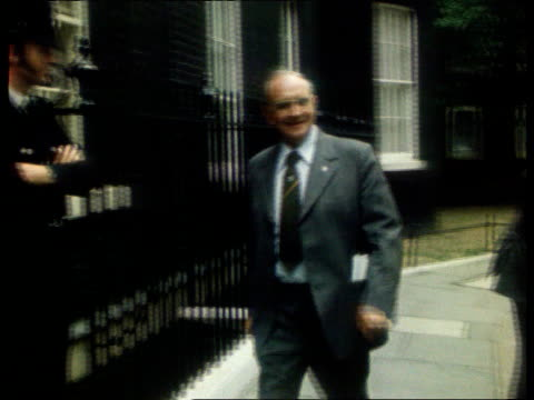 stockvideo's en b-roll-footage met announces radical reform of its structure; tx 1.9.76 england: london: downing street: ext union leader walking towards along pavement and past... - number 9
