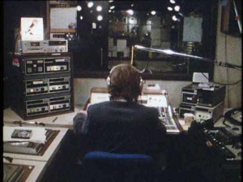 1982 dj announcing news in radio booth, nyc, ny - ラジオ放送点の映像素材/bロール