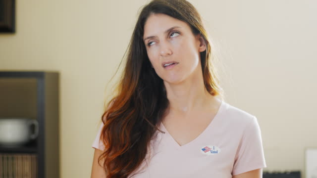 annoyed woman with i voted sticker - rolling eyes stock videos & royalty-free footage
