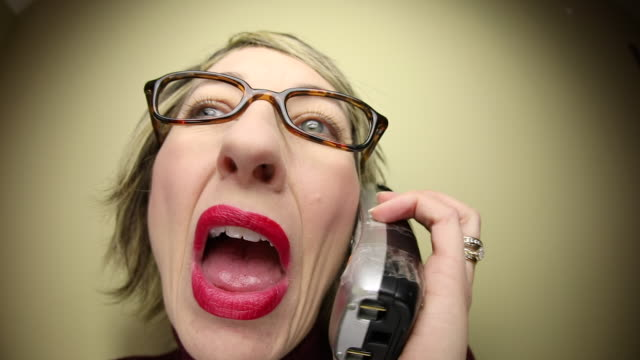 annoying fisheye woman talking on cordless phone - cordless phone stock videos & royalty-free footage