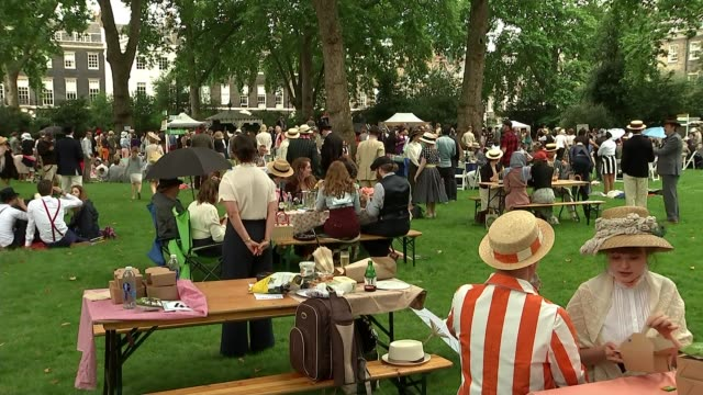 Annual 'Chap Olympiad' takes place in Bloomsbury ENGLAND London Bloomsbury EXT **Music heard intermittently SOT** People at 'Chap Olympiad' event Men...