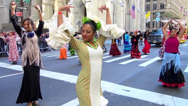 annual hispanic day parade on fifth avenue in manhattan, new york city, usa on october 11, 2015 / danza espa��ola, baile espa��ol o ballet espa��ol. - flamenco danza tradizionale video stock e b–roll