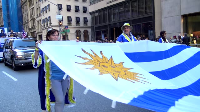 vídeos de stock, filmes e b-roll de annual hispanic day parade on fifth avenue in manhattan new york city usa on october 11 2015 - bandeira uruguaia