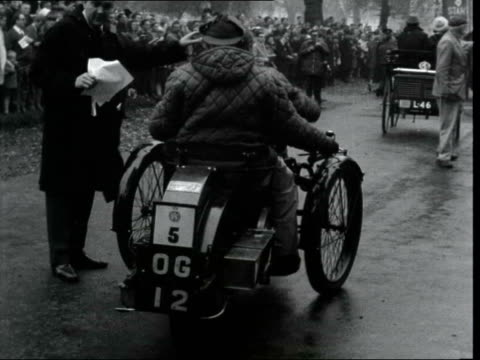 annual london to brighton veteran car run; england: london: ext two cars towards and past in park two cars over westminster bridge between london and... - curiosity stock videos & royalty-free footage