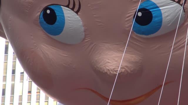 annual macy's thanksgiving day parade via manhattan new york city usa / elf on a shelf balloon - elf stock videos & royalty-free footage