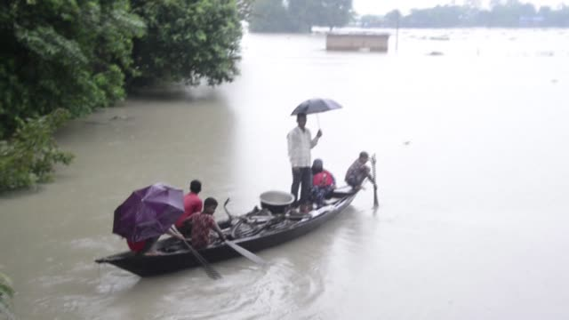 annual monsoon rains trigger widespread flooding in india's northeastern state of assam killing at least 16 and forcing residents to evacuate to... - trigger stock videos & royalty-free footage