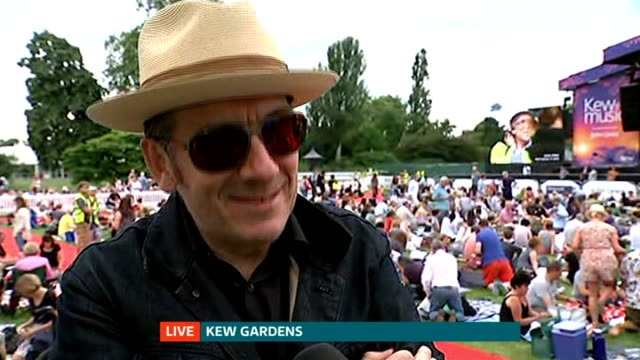 annual music festival 'kew the music' at kew gardens; england: london: kew gardens: ext reporter to camera elvis costello interview sot rory mcmanus... - elvis costello stock-videos und b-roll-filmmaterial