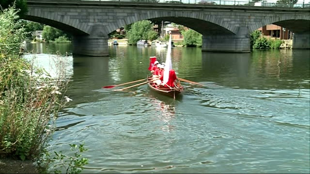 Annual tradition of swan upping on the Thames Swan markers into skiff boat Various of swan uppers rowing along ** Barber interview partly overlaid...