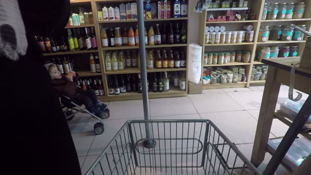anon interior gopro pov shots of earth natural foods health food shop, anon walking around the shop with a trolley in february 11th 2017 in kentish... - kentish town bildbanksvideor och videomaterial från bakom kulisserna