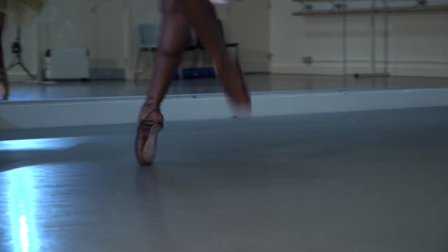 anonymous ballet dancer dancing on brown coloured pointe shoes to match skin tone - ballet dancing stock videos & royalty-free footage