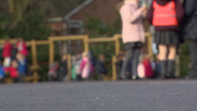 anonymous blurred shots of school children in school playground - playground stock videos & royalty-free footage