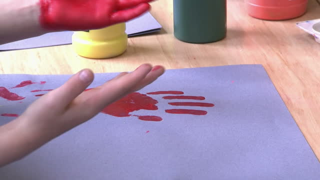 anonymous child finger paining in school classroom - art class stock videos & royalty-free footage