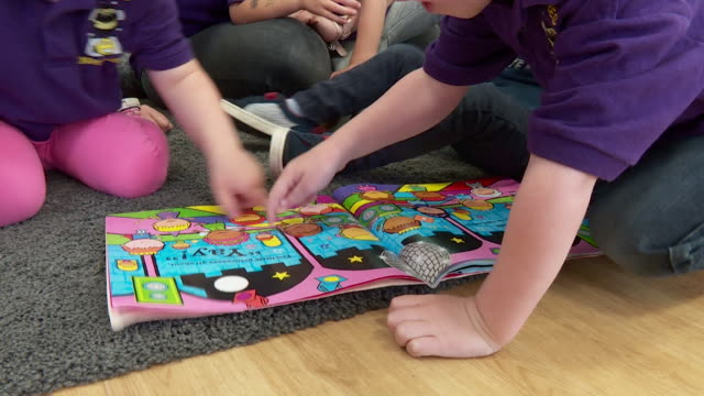 anonymous children looking through book at pre-school, essex - preschool stock videos & royalty-free footage