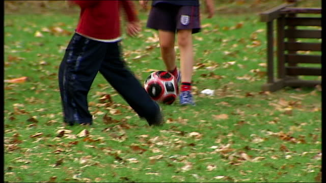 anonymous children playing in playground england london coram fields ext out of focus shots of children playing in park / legs of boys playing... - stabilisers stock videos & royalty-free footage