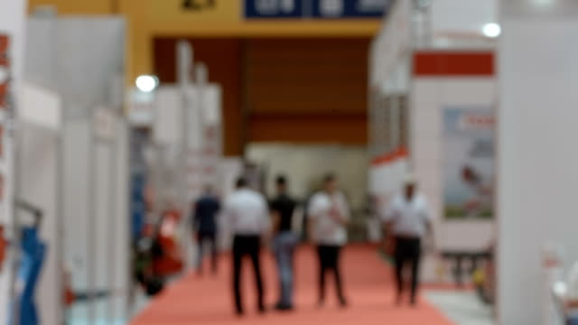anonymous crowd in fair - tradeshow stock videos & royalty-free footage