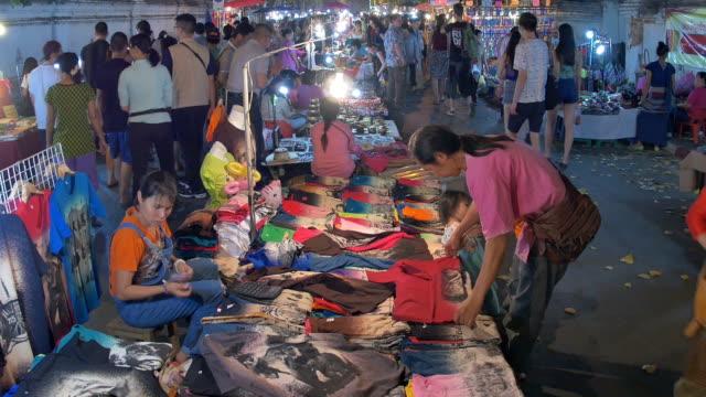anonymous crowd shopping in walking street - flea market stock videos & royalty-free footage