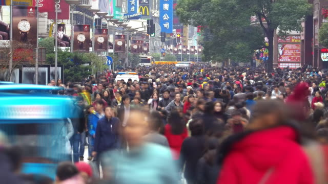 anonymous crowds on nanjing road time lapse - population explosion stock videos & royalty-free footage