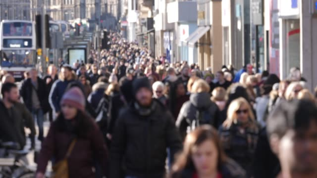 4K: Anonymous People / Shoppers walking in the City street